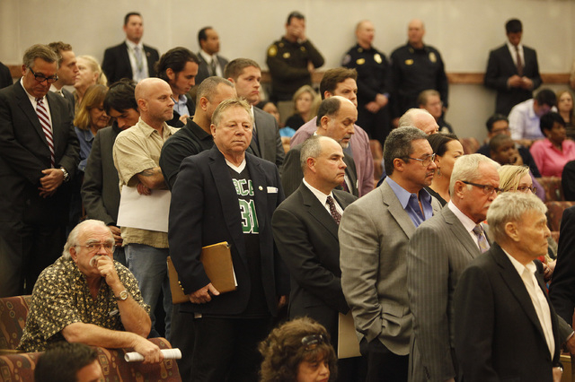 People line up to speak before the Clark County Commission in Las Vegas Tuesday, Jan. 21, 2014. The commission held public hearings on a tax increase to fund more police officers in Clark County.( ...