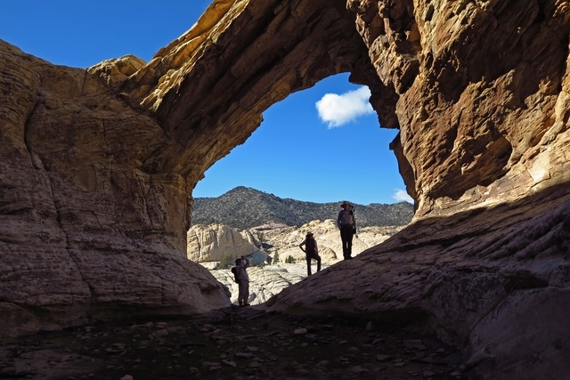 Bridge Mountain took its name from this arch, which has a watering hole at its base. A trailhead for it begins near the Willow Springs Picnic Area in Red Rock Canyon National Conservation Area. (K ...