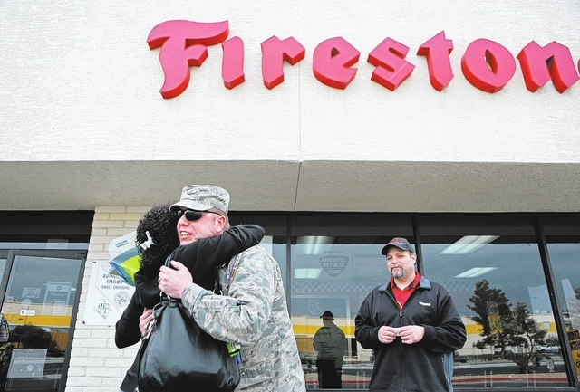 Doris Postelle, left, hugs United States Air Force Maj. Paul Hamel outside of Ted Wiens auto repair shop Thursday, Jan. 30, 2014, in North Las Vegas. Postelle paid $200 towards Hamelճ bill a ...