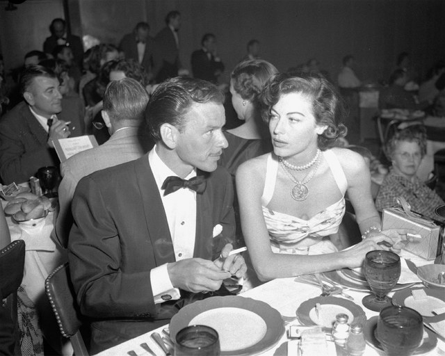 Singer Frank Sinatra and Ava Gardner dine together at Reno's Riverside Hotel, August 19, 1951, where Sinatra is filling a singing engagement while fulfilling the six weeks residence requirement fo ...