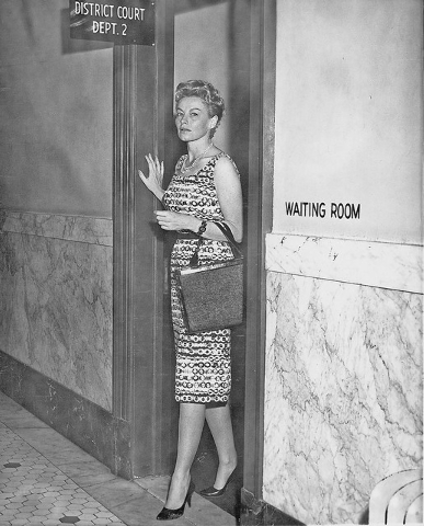 Striptease artist Lili St. Cyr leaves a Reno, Nev., courtroom after winning a divorce from her husband Edgar Friedman, July 22, 1959.  They had been married since 1955.  (AP Photo)