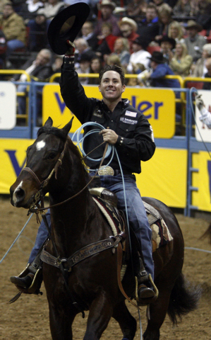 RJ FILE*** K.M. CANNON/REVIEW-JOURNAL Professional team roper Trevor Brazile of Decatur, Texas, salutes the crowd after clinching the all-around world rodeo championship title during the eighth ro ...