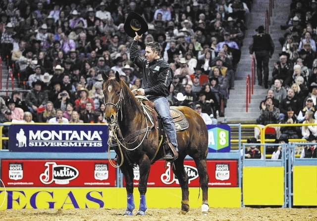 Trevor Brazile tips his hat to the crowd after competing in the Tie-Down Roping event during Day 7 of the Wrangler National Finals Rodeo at the Thomas and Mack Center in Las Vegas on Dec. 11, 2013 ...