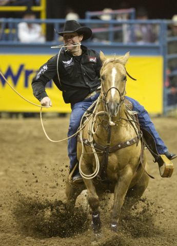K.M. CANNON/LAS VEGAS REVIEW-JOURNAL Trevor Brazile of Decatur, Texas, competes in calf roping on the final night of the 10-day National Finals Rodeo at the Thomas & Mack Center Saturday, Dec. 11, ...