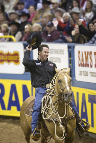 K.M. CANNON/LAS VEGAS REVIEW-JOURNAL Trevor Brazile of Decatur, Texas, acknowledges the crowd after competing in calf roping on the final night of the 10-day National Finals Rodeo at the Thomas &  ...