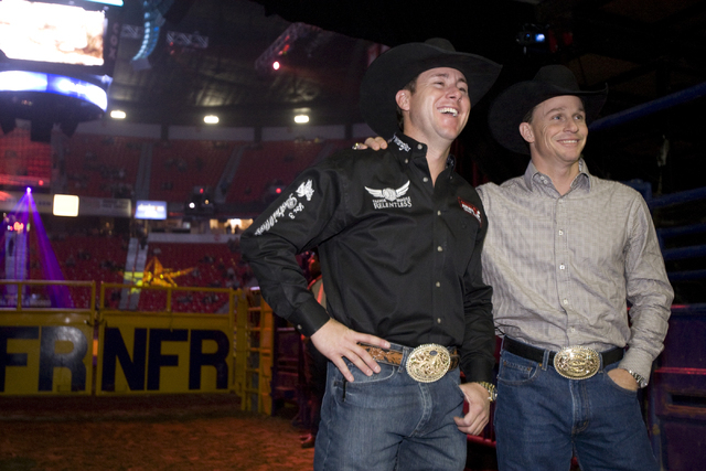 Eight-time All Around champion Trevor Brazile, left, poses with seven-time All Around champion Ty Murray before the start of the third go-around of the National Finals Rodeo at the Thomas & Mack C ...