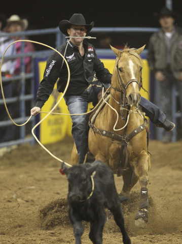 K.M. CANNON/LAS VEGAS REVIEW-JOURNAL Trevor Brazile, of Decatur, Texas, competes in the tie-down roping competition during the sixth go-around of the National Finals Rodeo at the Thomas & Mack Cen ...