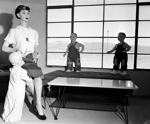 Mannequins that represent a typical American family, will soon experience the fury of an atomic blast with the power of 40,000 tons of TNT, at Yucca Flats, Nev., April, 24, 1955. The test is being ...