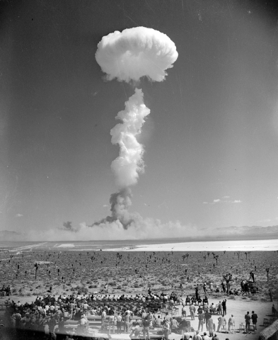 The mushroom cloud of an atomic bomb rises above Nevada's Yucca Flat April 22, 1952. Some 1,500 civilian observers, news people, ground soldiers and paratroopers in the air witnessed the blast. (A ...
