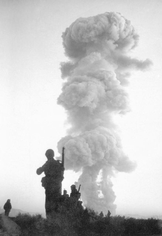 """Troops of the U.S. Sixth Army, stationed at Camp Desert Rock, advance on the """"enemy"""" moments after an atomic blast at Yucca Flats, near Las Vegas, Nev., June 1, 1952 This blast concluded ..."""