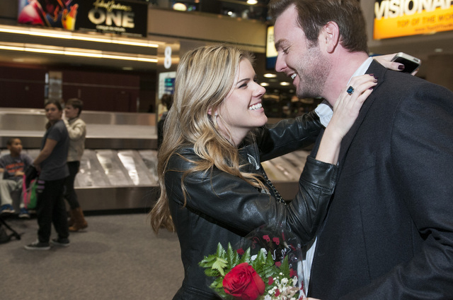 Brandon Taylor, right, and his girlfriend Emily Olsen share a moment as she arrives from her flight at McCarran International Airport on New Year's Eve Tuesday Dec. 31, 2013 in Las Vegas. (Erik Ve ...
