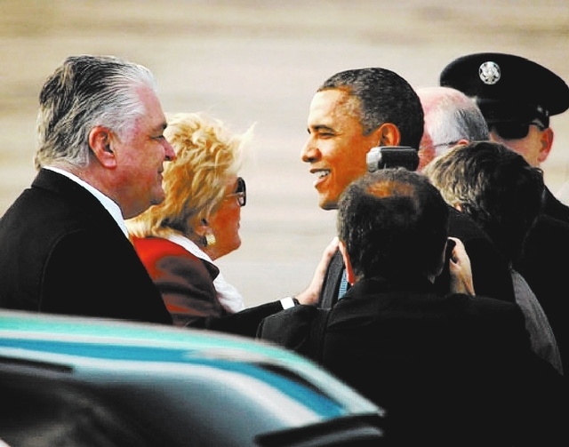 Clark County Commissioner Steve Sisolak, left, and Las Vegas Mayor Carolyn Goodman greet President Barack Obama at McCarran International Ariport Tuesday, Jan 29, 2013. He is unveiling his immigra ...