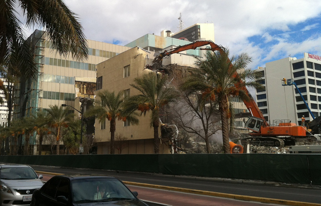 Construction crews on Friday, Jan. 31, 2014 use heavy machinery to rip down floors of the old Clark County Courthouse located at 200 S. Third St. in downtown Las Vegas. Derek Stevens, CEO of the D ...