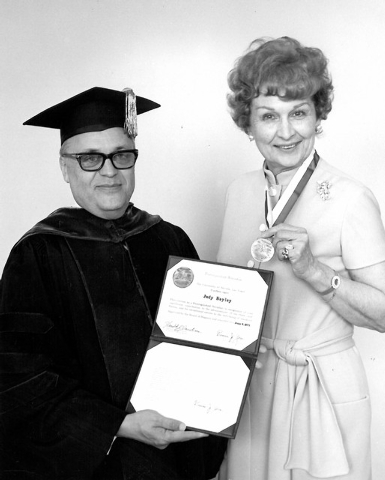 UNLV president Roman Zorn presents Judy Bayley with a certificate proclaiming her a distinguished Nevadan on June 6, 1971. (Special to View)