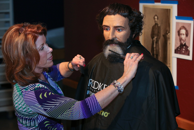 "Hairdresser Vikki Thompson styles the hair and beard of the John C. Fremont mannequin at the Nevada State Museum in Carson City, Nev., on Monday, Jan. 27, 2014. The ""Finding Fremont: Pathfind ..."