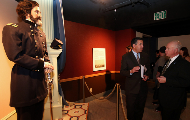 "Gov. Brian Sandoval and state Museums and History Director Peter Barton talk at the ""Finding Fremont: Pathfinder of the West"" exhibit grand opening at the Nevada State Museum, in Carson  ..."