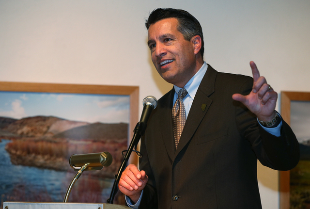 "Gov. Brian Sandoval speaks at the grand opening event for the ""Finding Fremont: Pathfinder of the West"" exhibit at the Nevada State Museum, in Carson City, Nev., on Wednesday, Jan. 29, 2 ..."