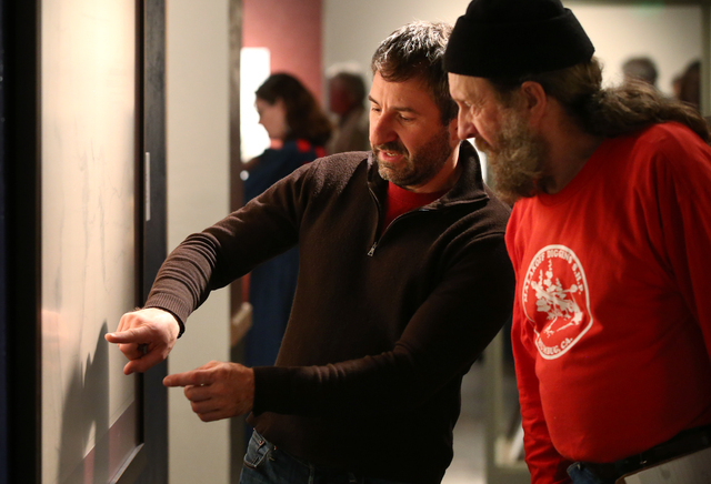 "Anthony Edwards, left, and Joel Tracy look at a map during the grand opening event for the ""Finding Fremont: Pathfinder of the West"" exhibit at the Nevada State Museum, in Carson City, N ..."