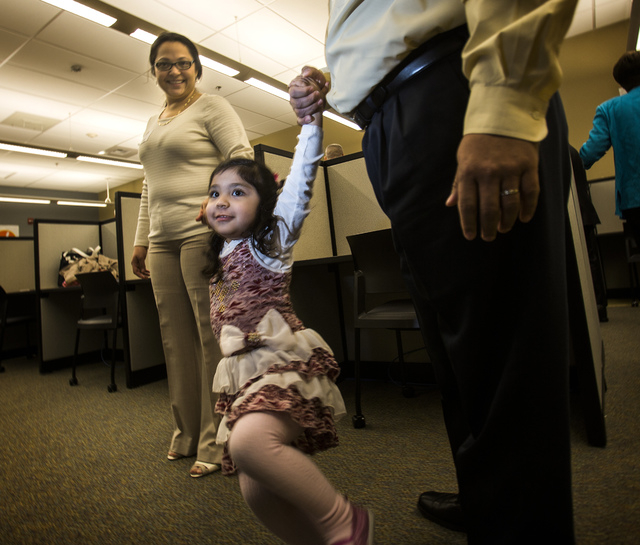 Mildred and Eddie Sigala hold their daughter, Mia, 3, during the ribbon-cutting Tuesday at the new community computer lab at Vegas PBS, 3050 E. Flamingo Road. Mildred Sigala took a dental assistan ...