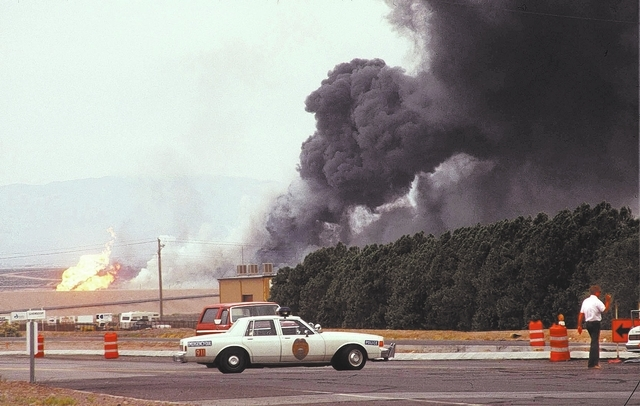 Black smoke billows from the Pacific Engineering Production Co. of Nevada plant in Henderson on May 4, 1988, after a fire and explosions rocked the Las Vegas Valley. Two were killed, and hundreds  ...