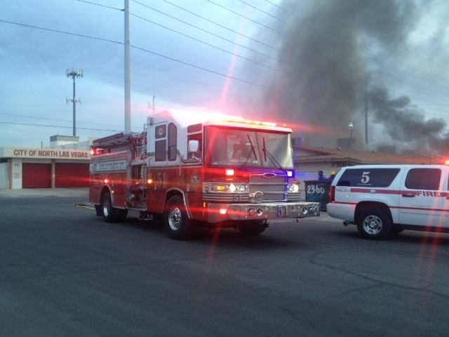 A fire truck is seen in the foreground as a blaze burns at an apartment early Thursday morning near the intersection of East Carey Avenue and North Daley Street in North Las Vegas. (Courtesy, Nort ...