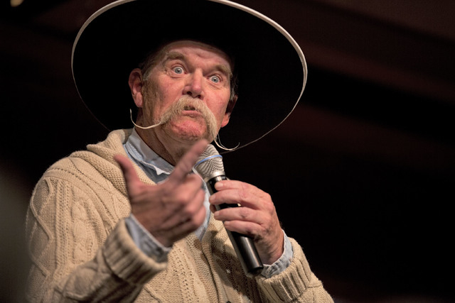 """Cowboy poet Waddie Mitchell makes a face while reciting a poem on Monday in the """"Home Means Nevada"""" show during the 30th National Cowboy Poetry Gathering at the G Three Bar Theater of the Western  ..."""