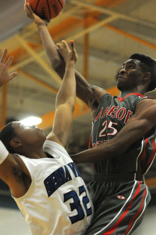 Arbor View's Justin Burks (25) takes a shot at the basket over Sierra Vista's defender Dominique Marcy (32) during an away game at Sierra Vista High School in Las Vegas Friday, Jan. 24, 2014. Arbo ...