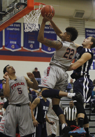 Findlay Prep's Kelly Oubre (22) goes to the hoops against  Impact Academy's Hunter Eisenhower (15) at Bishop Gorman in Las Vegas on Saturday, Jan. 11, 2014. (Jason Bean/Las Vegas Review-Journal)