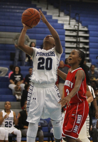 Canyon Springs' Alexia Thrower (20) shoots over Alaihya Williams (3) during their girl's basketball game in North Las Vegas on Jan. 28, 2014. (Jason Bean/Las Vegas Review-Journal)