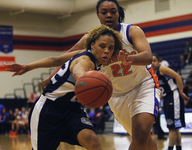 Centennial's Teirra Hicks (22) reaches for a loose ball against Bishop Gorman's Raychel Stanley (22) during their girl's basketball game in Las Vegas on Wednesday, Jan. 29, 2014. (Jason Bean/Las V ...