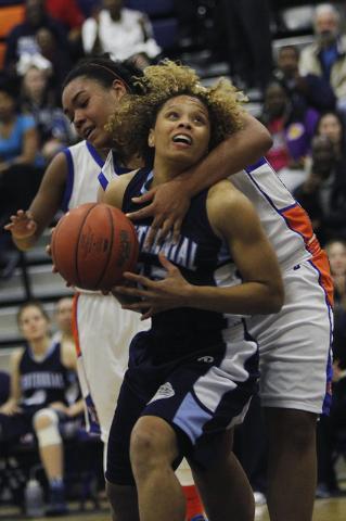 Centennial's Teirra Hicks (22) gets fouled by Bishop Gorman's Raychel Stanley (22) during their girl's basketball game in Las Vegas on Wednesday, Jan. 29, 2014. (Jason Bean/Las Vegas Review-Journal)
