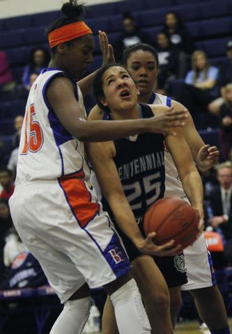 Centennial's Karina Brandon (25) tries to drive past  Bishop Gorman's Raychel Stanley (22) and Maddison Washington (15) during their girl's basketball game in Las Vegas on Wednesday, Jan. 29, 2014 ...