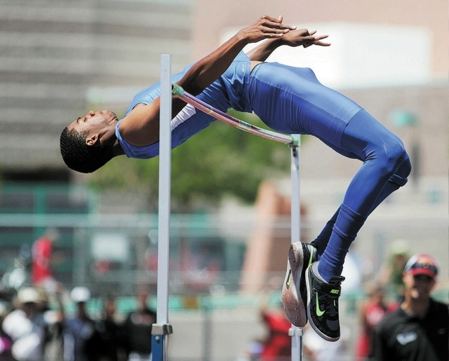 Bishop Gorman's Randall Cunningham clears 7 feet, 3¼ inches to win the state high jump title on May 18. The senior made an oral commitment to attend Southern California. (Ronda Churchill/Las Ve ...