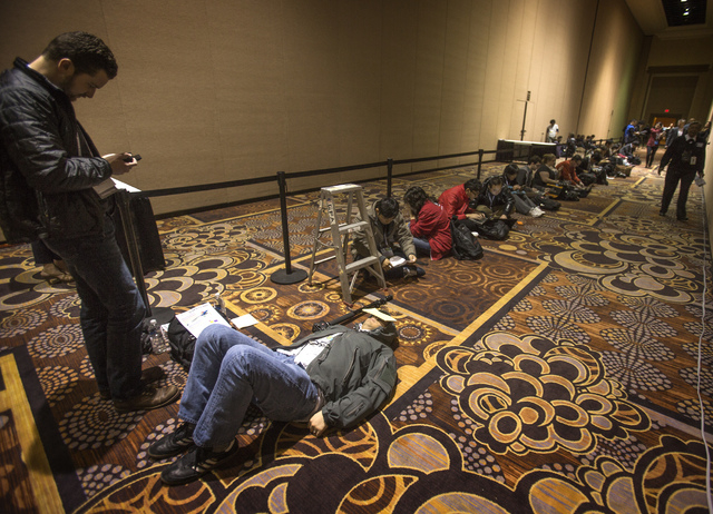 People line up during CES International Press Day at Mandalay Bay Convention Center on Monday. The annual electronic show featuring the latest in consumer technology begins Tuesday. More than 150, ...