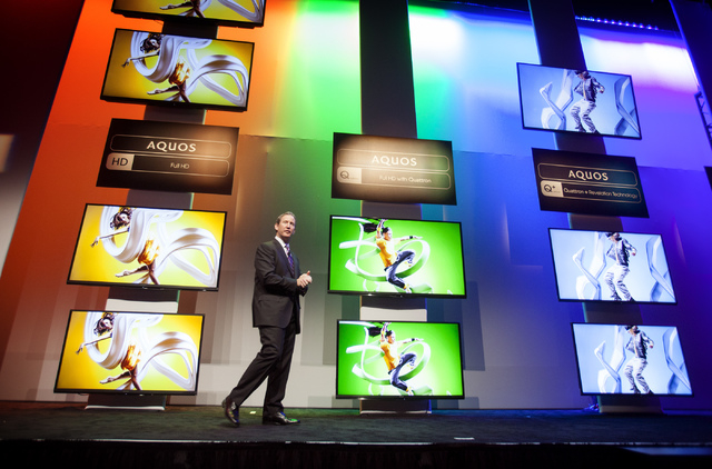 Jim Sanduski, VP of strategic product marketing, unveils of the latest lines Sharp Aquos TV  during CES International Press Day at Mandalay Bay Convention Center on Monday. The annual electronic s ...