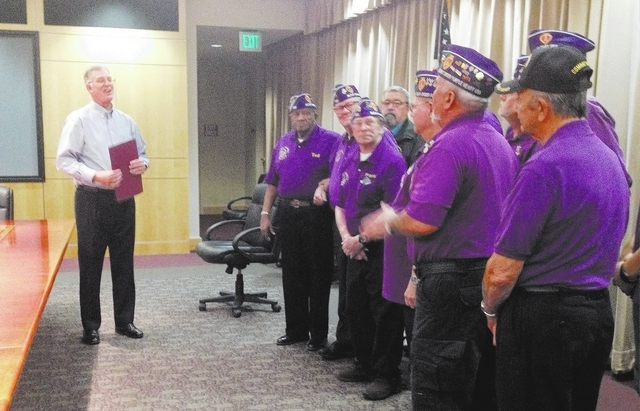 Mayor Andy Hafen, left, proclaims Henderson a Purple Heart City on Monday while members of Military Order of the Purple Heart Chapter 730 stand in the mayor's conference room. (Keith Rogers/Las Ve ...