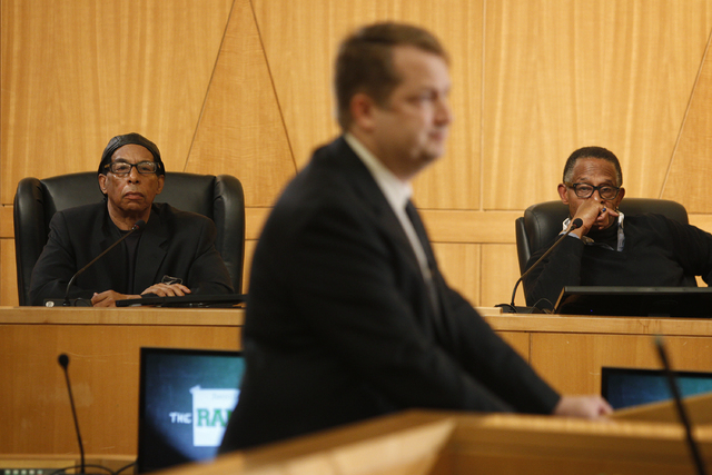 Stan Armstrong, left, and Antonio Vargas talk about the race riots at Rancho High School during a panel discussion at the Clark County Commission Chambers in Las Vegas Friday, Jan. 24, 2014. (John ...