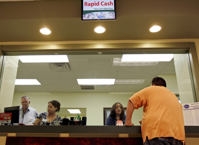 A customer completes a transaction at Rapid Cash at 4241 S. Nellis Blvd., on Friday June 20, 2008, in Las Vegas. (Louie Traub, Las Vegas Review-Journal)