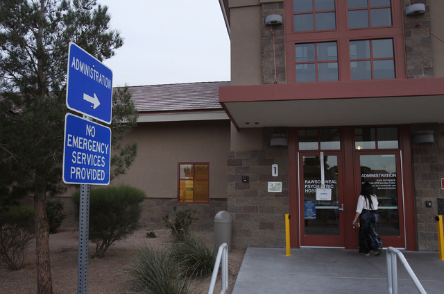 A woman walks into the Rawson-Neal Psychiatric Hospital in Las Vegas Friday, Jan. 24, 2014. The outpatient clinic at the hospital closed down. (John Locher/Las Vegas Review-Journal)