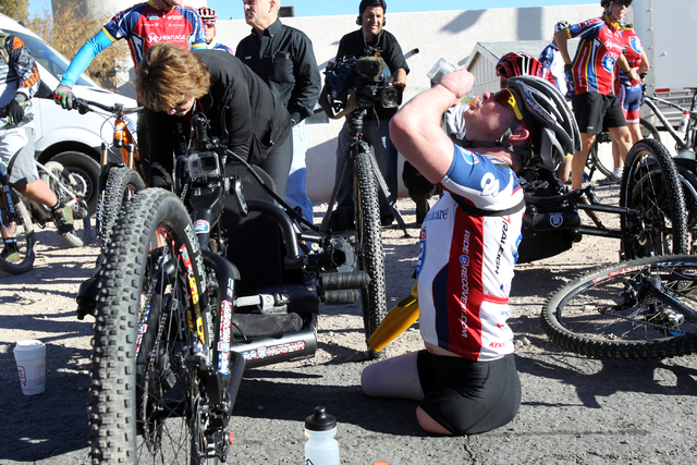 Tim Brown, a Marine who lost three limbs after stepping on an improvised explosive device in Afghanistan in 2011, prepares in Blue Diamond for a ride through Red Rock Canyon for the Ride 2 Recover ...