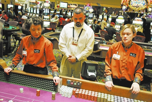 Joe Gonzales, table games manager, watches over a game similar to craps at Harrah's Rincon in California on April 6, 2006. (John Locher/Las Vegas Review-Journal file photo)