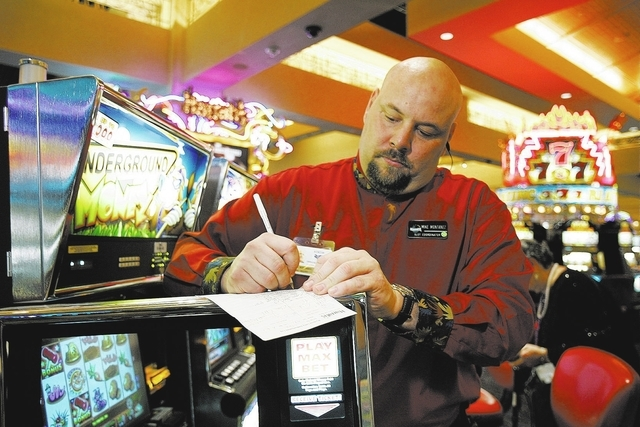 Slot host and former Las Vegan Mike Montenez fills out paperwork on a machine at Harrah's Rincon in California on April 6, 2006. (John Locher/Las Vegas Review-Journal file photo)