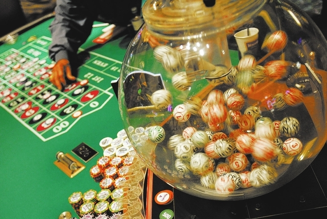 People place bets at the Volcanic Single Ball Roulette table at Harrah's Rincon in California April 6, 2006. (John Locher/Las Vegas Review-Journal file photo)