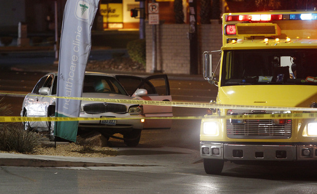 A damaged car is seen at the scene of a fatal road rage incident near the corner of Tropicana Avenue and Rainbow Boulevard in Las Vegas Tuesday, Jan. 21, 2014. (John Locher/Las Vegas Review-Journal)