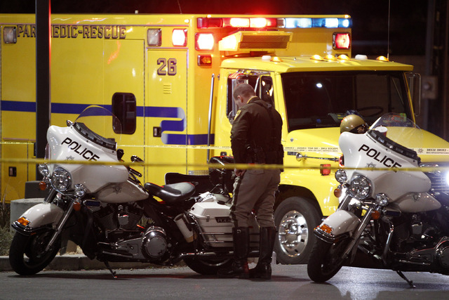 Police and paramedics are on the scene of a fatal road rage incident near the corner of Tropicana Avenue and Rainbow Boulevard in Las Vegas Tuesday, Jan. 21, 2014. (John Locher/Las Vegas Review-Jo ...