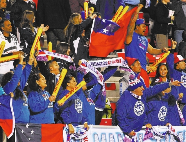 Fans cheer the Samoan team during its 22-19 victory over England on the first day of pool play in the USA Sevens rugby tournament Friday at Sam Boyd Stadium. (Chase Stevens/Las Vegas Review-Journal)