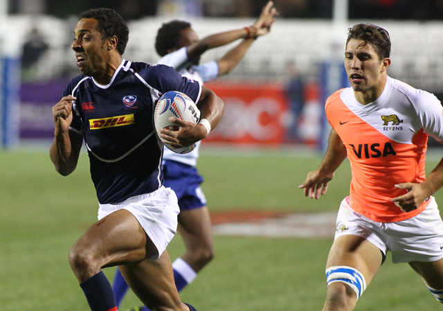 USA's Nick Edwards (2) runs the ball to score ahead of Santiago Alvarez, right, of Argentina during the first day of the USA Sevens rugby tournament at Sam Boyd Stadium in Las Vegas on Friday, Jan ...