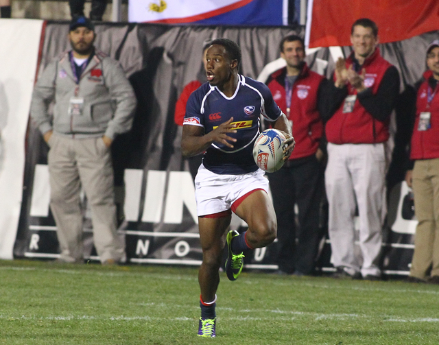 USA's Carlin Isles (1) runs the ball to score against Argentina during the first day of the USA Sevens rugby tournament at Sam Boyd Stadium in Las Vegas on Friday, Jan. 24, 2014. (Chase Stevens/La ...