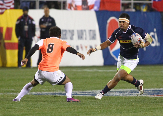 USA's Folau Niua (7) looks to get past Argentina's Gaston Revol (8) during the first day of the USA Sevens rugby tournament at Sam Boyd Stadium in Las Vegas on Friday, Jan. 24, 2014. (Chase Steven ...