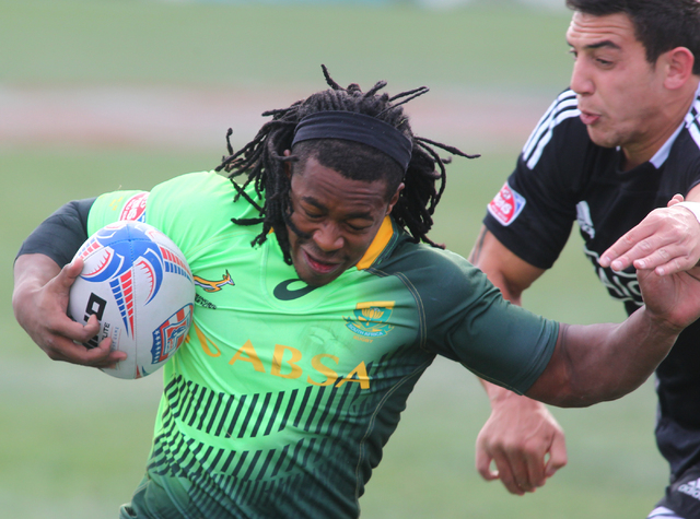 South Africa's Branco du Preez runs the ball to score as New Zealand's Bryce Heem attempts to tackle during the cup final of the USA Sevens rugby tournament at Sam Boyd Stadium in Las Vegas on Sun ...